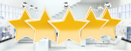 Five digital gold ranking stars on white office background 3D rendering