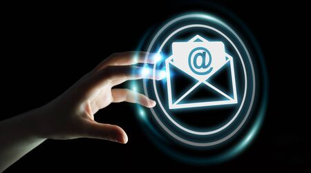 letter: Businesswoman on blurred background touching 3D rendering flying email icon with her finger