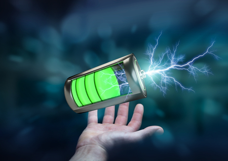 Man on blurred background holding 3D render battery with lightning in his hand Stock Photo