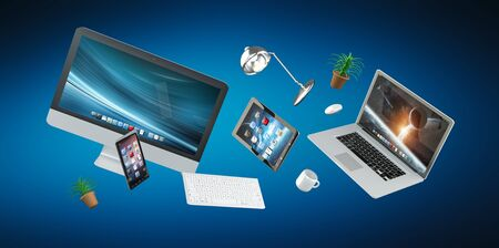 office desk: 3D rendering flying workplace with laptop phone and tablet on blue background Stock Photo
