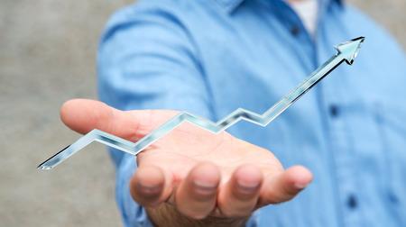 Businessman holding digital blue arrow in his hand 3D rendering