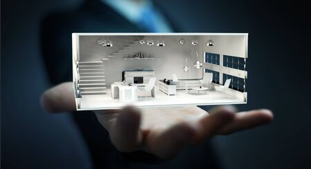 home office interior: Businessman on blurred background holding white 3D rendering apartment