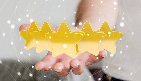 review: Young businessman ranking with his hand using digital stars 3D rendering Stock Photo