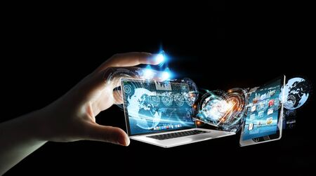 Businesswoman on blurred background connecting tech devices 3D rendering Stock Photo