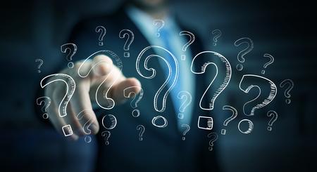 Geschäftsmann auf unscharfen Hintergrund berühren Hand gezeichnet Fragezeichen mit seinen Fingern Standard-Bild - 73779578