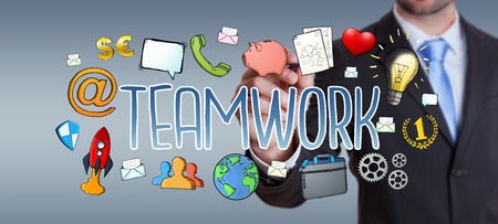 cooperate: Businessman on blurred background using hand-drawn teamwork presentation
