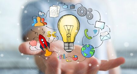Businessman holding hand drawn lightbulb in his hand with multimedia icons flying around