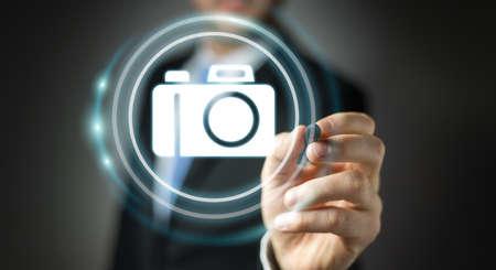 megapixel: Businessman on blurred background using modern camera application 3D rendering Stock Photo