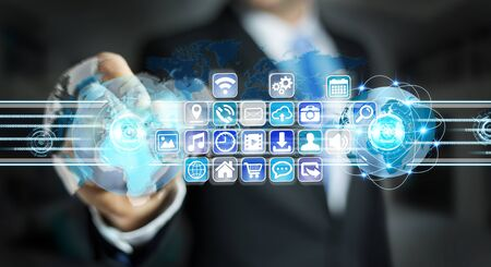 Businessman on blurred background connecting worlds to icons and applications software 3D rendering