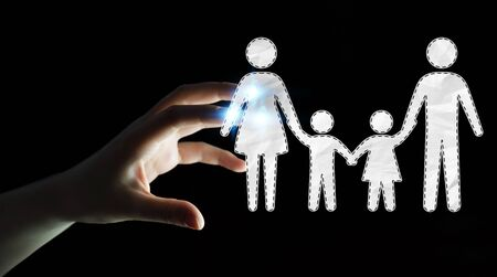 child protection: Businesswoman on blurred background holding family interface in his hand 3D rendering