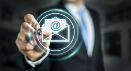 contact info: Businessman on blurred background touching 3D rendering flying email icon with a digital pen