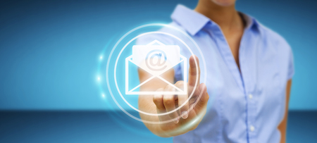 contact: Businesswoman on blurred background touching 3D rendering flying email icon with her finger