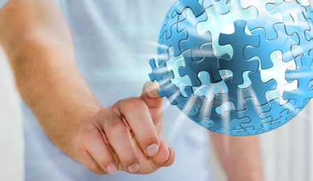 problem: Businessman touching flying puzzle sphere with his finger '3D rendering'