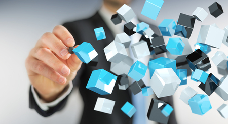 international internet: Businessman on blurred background holding floating blue shiny cube network 3D rendering
