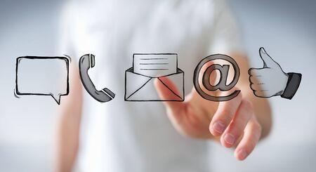 Hombre de negocios en el fondo borroso tocar icono de contacto manuscrito con su dedo