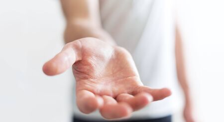 palm: Businessman on blurred background showing his empty hand Stock Photo