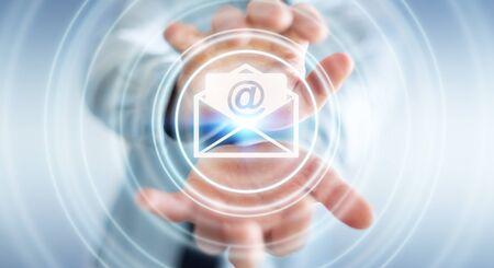 Hombre de negocios en el fondo enmascarado que sostiene representación 3D volar icono de correo electrónico en la mano