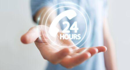 hotline: Businessman on blurred background using hotline customer assistance 3D rendering Stock Photo