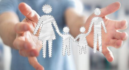 child protection: Businessman on blurred background holding family interface in his hand 3D rendering