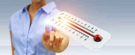 Businessman checking the temperature rise with a thermometer 3D rendering