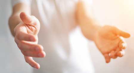 fingers: Businessman on blurred background showing his empty hand Stock Photo