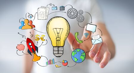 Businessman touching hand drawn lightbulb with his fingers with multimedia icons flying around