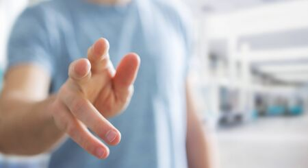 fingers: Businessman on blurred background pointing his finger