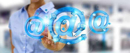 contact: Businesswoman on blurred background touching 3D rendering email icon with his finger