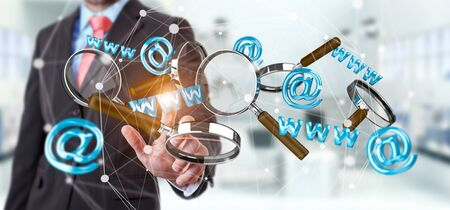 Businessman on blurred background touching 3D rendering contact icon and magnifying glass in his hand