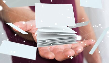 profession: Businessman holding white floating business card in his hand 3D rendering Stock Photo