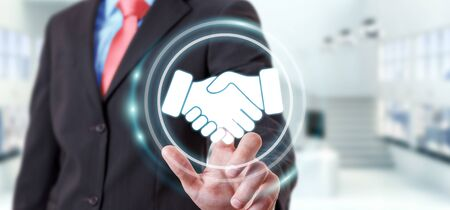 cooperate: Businessman on blurred background using digital presentation for partnership business 3D rendering Stock Photo