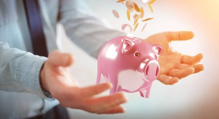golden: Businessman on blurred background holding piggy bank with flying coins going inside 3D rendering