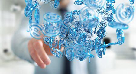 Businessman on blurred background using digital arobase blue sphere to surf on internet 3D rendering