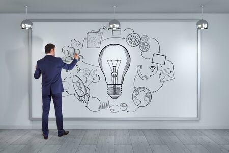 lamp light: Businessman in modern interior drawing innovation sketch on a board 3D rendering