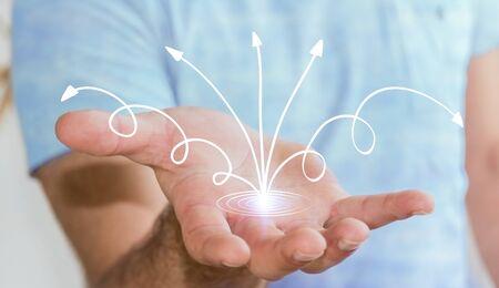 ganancias: Man using hand-drawn business presentation in his hand on blurred background