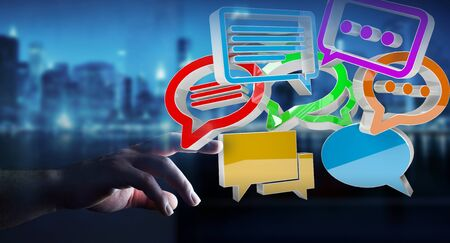 Businesswoman on blurred background using digital colorful 3D rendering conversation icons Stock Photo