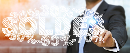 fingers: Businessman on blurred background touching sales icons with his finger 3D rendering Stock Photo