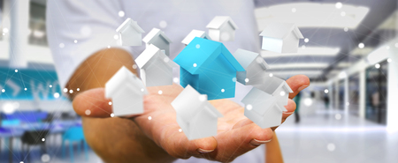 project: Businessman on blurred background using 3D rendered small white and blue houses Stock Photo