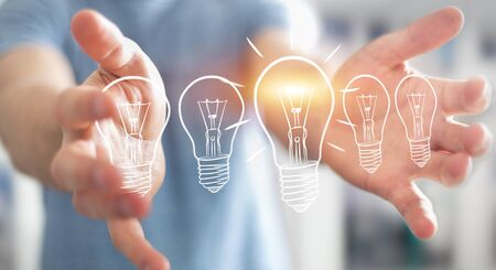 invent: Businessman on blurred background holding a sketch lightbulb Stock Photo