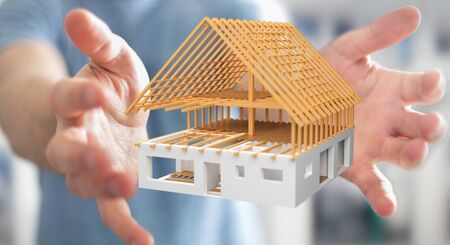 unfinished building: Businessman on blurred background holding 3D rendering unfinished plan house in his hand