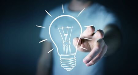 lamp light: Businessman on blurred background touching a sketch lightbulb Stock Photo