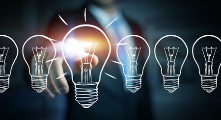 Businessman on blurred background touching a sketch lightbulb Stock Photo