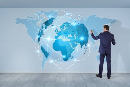 Businessman in modern interior using digital planet earth interface on a wall 3D rendering