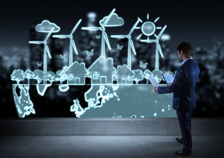 rendering: Businessman watching renewable energy sketch on a rooftop with a city view 3D rendering