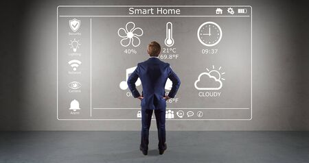home office interior: Businessman in modern interior using smarthome interface on a wall 3D rendering
