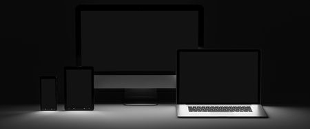 Modern computer laptop mobile phone and tablet in the dark 3D rendering Stock Photo