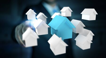 rendering: Businessman on blurred background using 3D rendered small white and blue houses Stock Photo