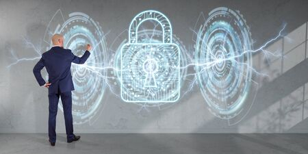 cyber defence: Businessman in modern interior using antivirus interface on a wall 3D rendering