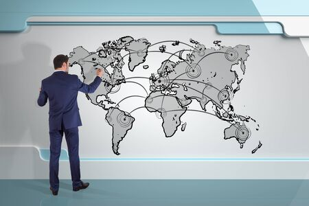info: Businessman in modern interior drawing manuscript world map connection on a board 3D rendering Stock Photo