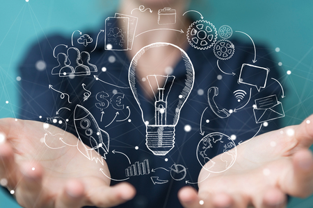 Businesswoman on blurred background touching and holding sketch lightbulb